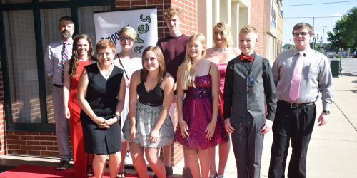 Standing in the back row on the red carpet before the event are Brent Kabo, Jaclyn Meyer, Katy Shepherd, Jack Stewart, Brianna Guilliam and Nate Myer. Standing in the front row are Jessica Hardy, Sarah Hewitt, Wakelyn Hudson and Ian Peloza.