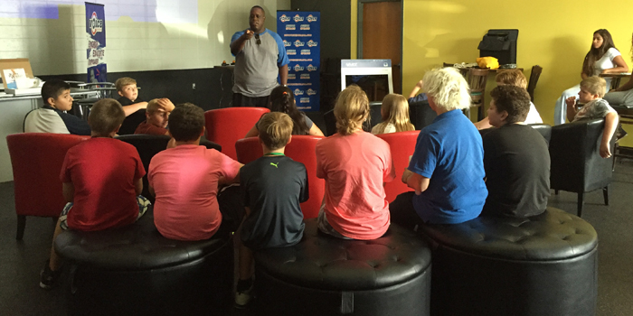 Samuel Allen speaking to kids at the Baker Youth Club.