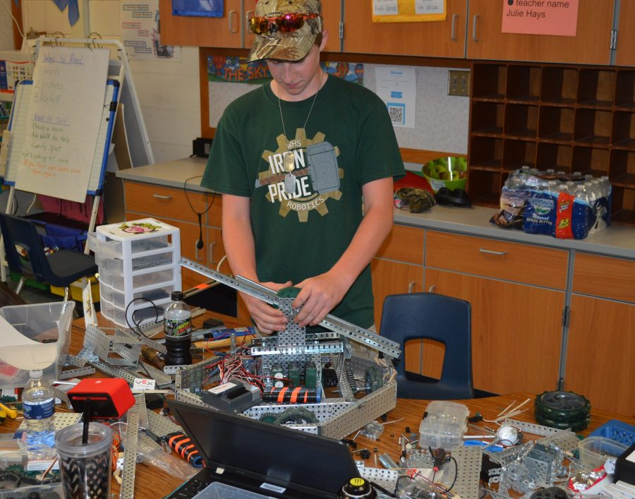 Ethan Hays, Wawasee High School student, works with a robot during a summer camp for robotics.