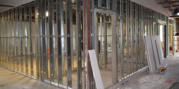 Metal framework at Edgewood Middle School shows where a classroom will soon be.