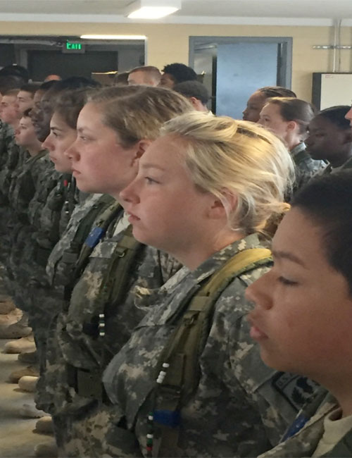Warsaw Army JROTC Cadets Emily Puckett and Jessica Gerkin, third and second from right, receive a briefing. (Photo provided)