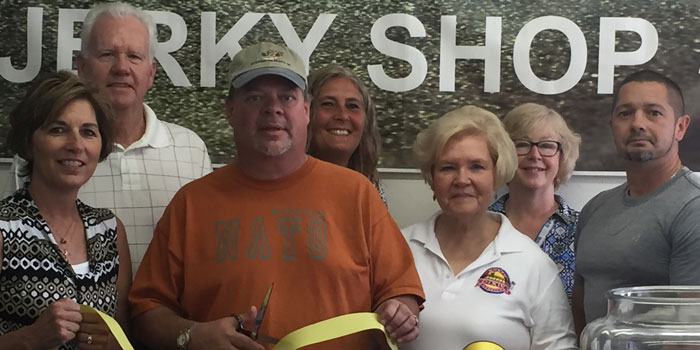 In front, from left, are the North Webster Chamber of Commerce's Brenda Peterson, Jerky Shop's Tom Bentele, Karilyn Metcalf and Chris Lusso, both of the chamber. Representing the chamber in back are Terry Frederick, Sue Ward and Helen Leinbach. The North Webster location of the Jerky Shop had a ribbon cutting. (Photo by Martha Stoelting)