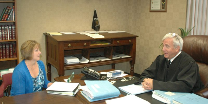CASA director Mackenzie Cloutier, left, meets with Judge David Cates regularly to discuss cases involving the welfare of children. Last year saw a spike in cases in cases involving children in need of services, and CASA is holding a training session starting July 19 to meet the growing demand for child advocates in the court system.