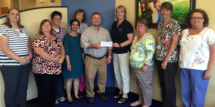 Pictured from left are Abbie Sutton, Sherri Ramsey, Faith Wagoner, Dr. Neeta Jain, Susan Stephens, Dr. Todd Dillon, Tracey Akers of Warsaw Schools, Jeni Pritchard, Jenny Baker and Jan Nelson. (Photo provided)