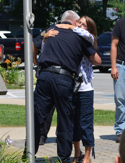 Chief Joe Hawn and organizer Courtney Jenkins hug following the prayer event.