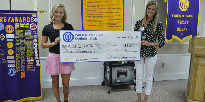 Pictured from left are Camille Kerlin, representing Racquets for Riley, and Jen Kerns, representing the Warsaw Breakfast Optimist Club.(Photo provided)