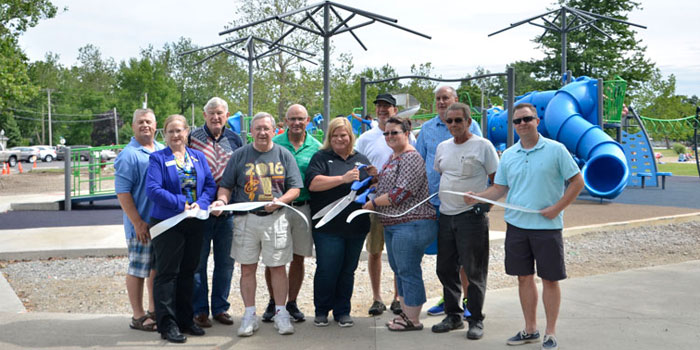 Limitless Park ribbon cutting to commemorate phase 2.1 of the park project. From left are; Jennifer Vaneburg, North Central District OCRA liason; Dennis Daniels, redevelopment commission; Holly Hummitch, parks director; Jill Schroeder, park board; Jerry Newton, Newton Excavating; Chad James, park board. Back row from left; Rob Parker, Chamber of Commerce; John Elliot redevelopment commission; Denny Duncan, Winona Lake town council; Rick Swain, Winona Lake town council and Craig Allebach, town coordinator (Photo by Michelle Reed)