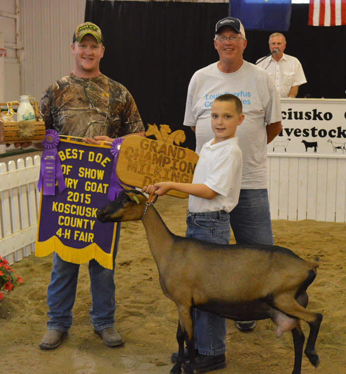 Kaleb Dausman, holding the goat, was among the 4-H'ers participating in the annual sale of champions at the 2015 Kosciusko County Fair. Dausman sold milk from his Grand Champion Senior Doe. The milk was sold to Louis Dreyfus Commodities for $1,450. The total sale last year brought in $417,544.28.
