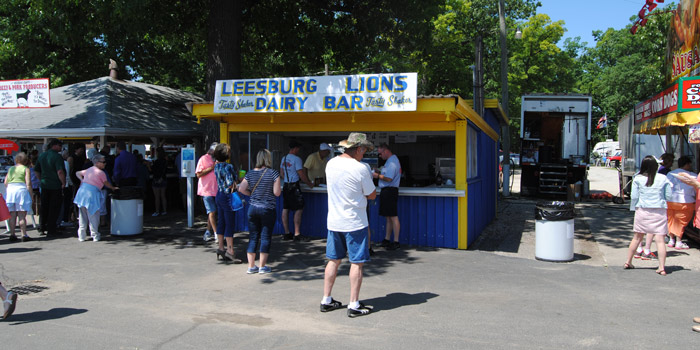 Several local organizations have food booths at the Kosciusko County Community Fair, serving a variety of meals and desserts. Additionally, many of the proceeds from these booths stay local or are used for good causes. Show is one of two booths the Leesburg Lions man serving ice cream and other treats.