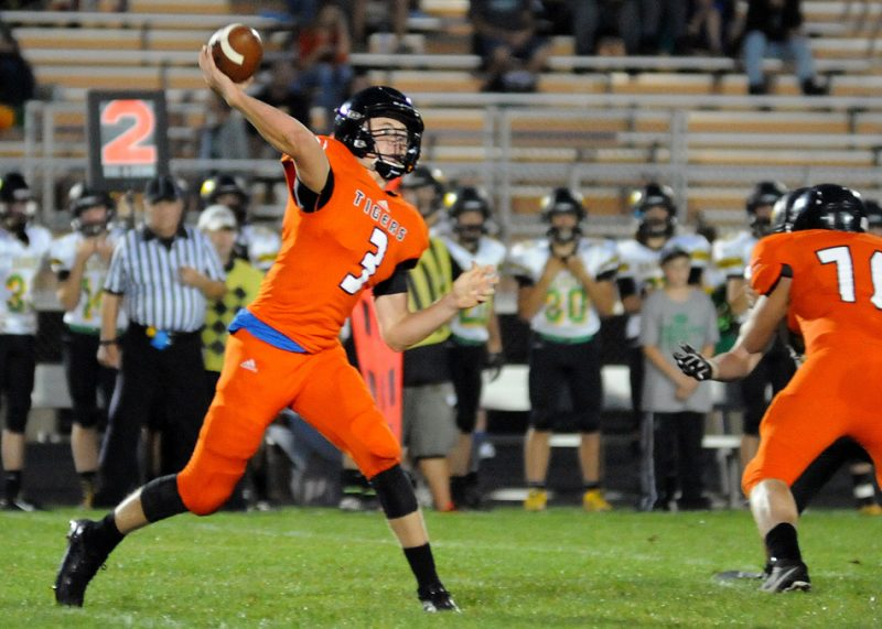 Warsaw senior Michael Jensen is ready to capitalize on his final season under center for the Tigers. (File photo by Mike Deak)