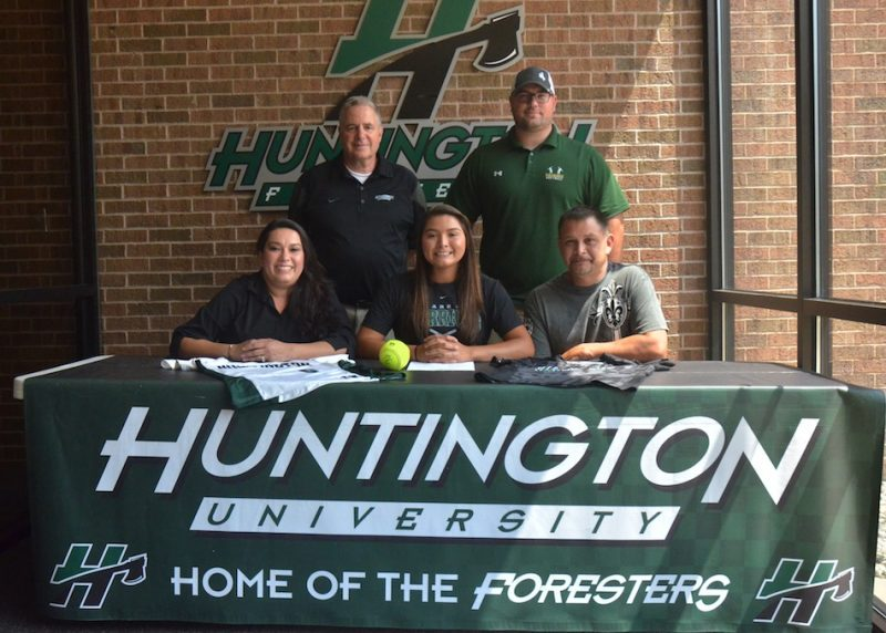 Allissa Flores signed with Huntington University Friday. Pictured, in front from left, are Zulema Flores, Allissa Flores and John Flores. In the back, Huntington coach Doug Gower and former Wawasee softball coach Jared Knipper. (Photo by Nick Goralczyk)