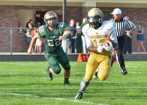 Anthony Coleman (12) gets chased down by Michael Katzer.