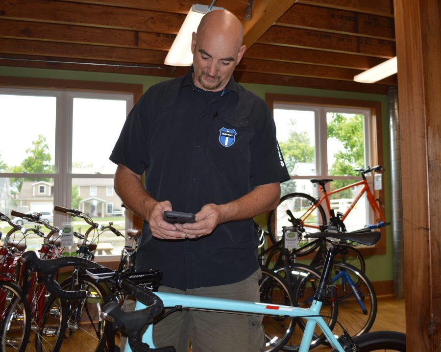 As demonstrated by Barry McManus, owner of Trailhouse Village Bicycles, using a smartphone is popular among bicycle enthusiasts to track mileage, speed and routes ridden.