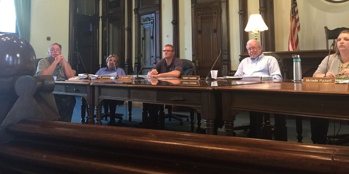 The County Council paying rapt attention to George Robertson giving the economic quarterly report, from left: Councilman Jon Garber; Councilman Larry Teightmeyer; Councilman Jon Fussle; County Council President Bob Sanders and County Auditor Michelle Puckett