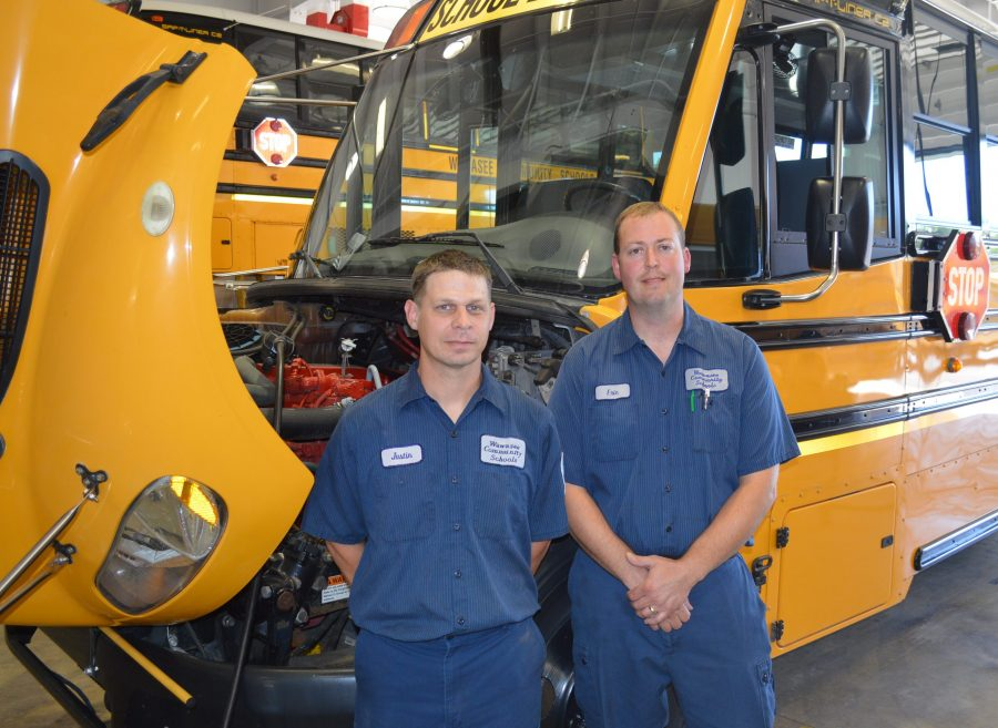 Justin Green, left, and Eric Jackson service a fleet of 63 buses for Wawasee schools in addition to the other school corporation vehicles. The most recent Indiana State Police bus inspection was infraction free for Wawasee.