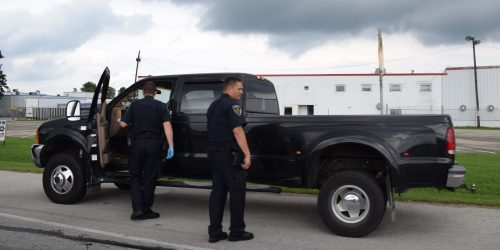 Officers search the truck involved in the pursuit.