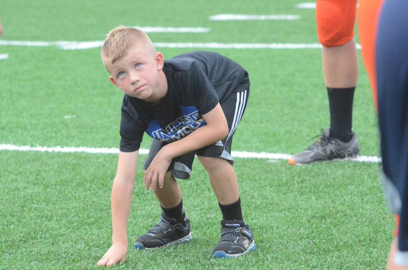 A camper listens for instructions from a Warsaw player Friday night. The Tigers held a camp prior to their scrimmage with Tippecanoe Valley.