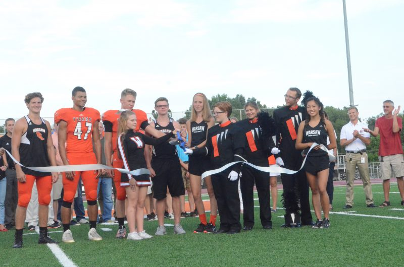 Members of the WCHS student body cut the ribbon for the new synthetic turf field Friday night.