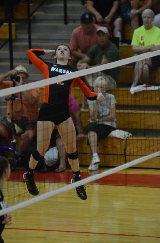 Nikki Parrett shows off her hops at the net for Warsaw.