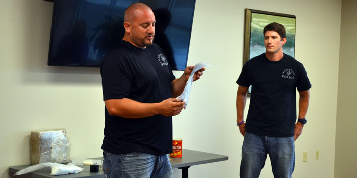Detective Sergeant RJ Nethaway, Narcotics, Warsaw Police Department, left, and Trooper Andrew Cochran, Meth Suppression, Indiana State Police, talk to parents about drug addiction in teens. (Photos by Amanda McFarland)