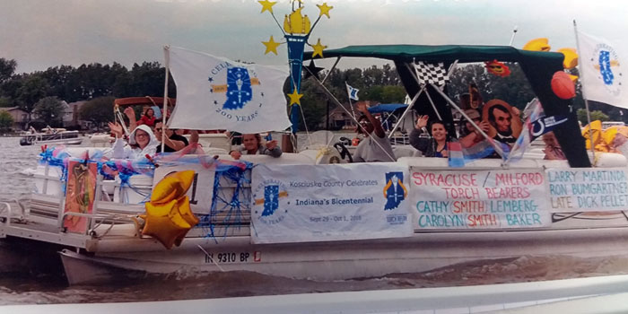 A flotilla float on Wawasee honored Syracuse's bicentennial torchbearers earlier this spring. (Photos provided)