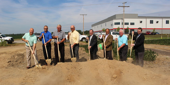 Rick Powers, Kevin Overmyer, Mayor Mark Senter, Mike Miley and other Plymouth local leaders break ground together