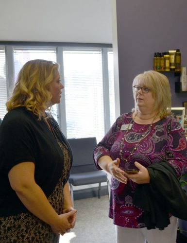 From left, Inspire College of Cosmetology Instructor Nikki Lawrence and Warsaw Area Career Center Director Ronna Kawsky discuss different aspects of the program.