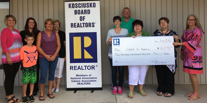 From left are KBOR PR committee members Shelley Dobbins, Leanne Francis, son Caden Francis, Lori Rockwell and Jan Miller; Habitat family Gina and Lee Ratliff; KBOR PR committee members Marcia Anderson and Nanette DeGaetano; and Habit for Humanity President Diana Creech. (Photo provided)