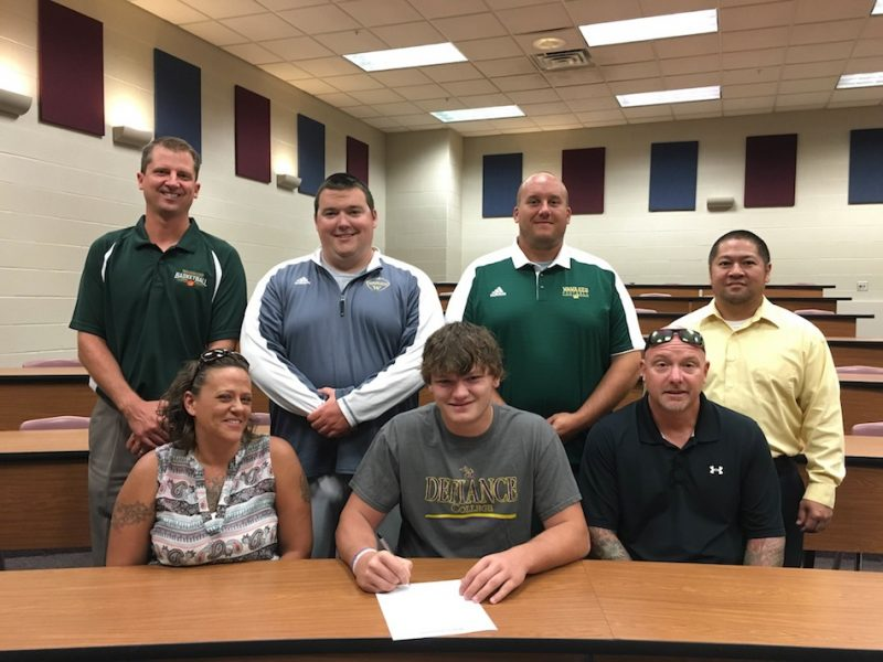 Wawasee's Austin Pearish signed to play football at Defiance College Thursday. Pictured in front, from left, are Samantha Pearish, Austin Pearish and Ken Pearish. In the back is vice principal Vince Beasley, assistant football coach Adolph Hathaway, head coach Josh Ekovich and principal Kim Nguyen.