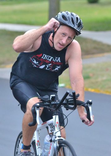 Tony Klepinger shows the camera some love during the biking portion of Saturday's Wawasee Tri. (Photos by Nick Goralczyk)