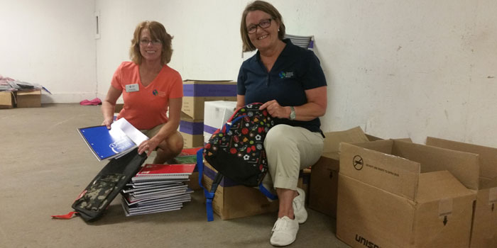 Tammy Smith, left, and Peggi Lisenbee Wright show some of the school supplies available. (Photos by Amanda McFarland)