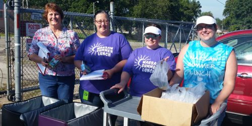 From left, Sheila Tenner, Angie Rucker, Jen Hart and Courtney Ruggier hand out breakfast items during Tools for Schools.