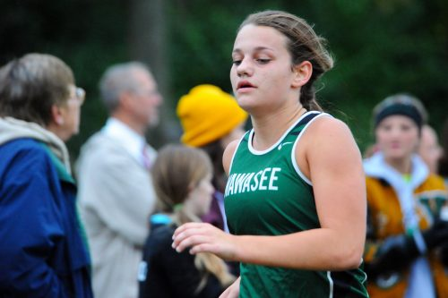 Shelby Adams has built a reputation as swimmer, but is hoping to be the backbone of the cross country team this season. (File photo by Mike Deak)