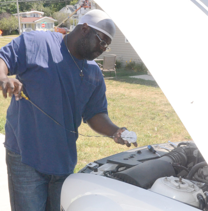 DeMario Loston has enjoyed working on cars for a number of years, even before getting his mechanic's certificate.
