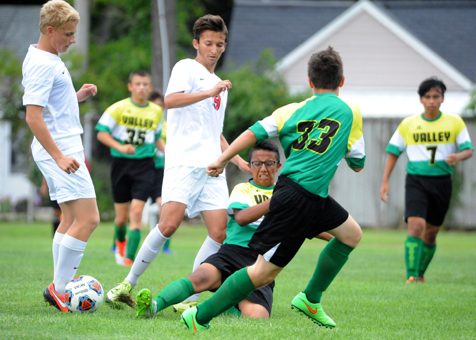 Tippecanoe Valley's Diego Hernandez slides in to disrupt NorthWood's Dylan Weldy Thursday in the boys soccer opener for both schools. (Photos by Mike Deak)