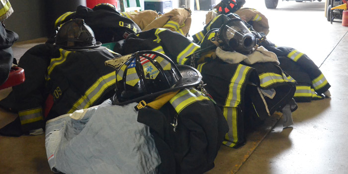 Shown is turnout gear of full time, part-time and volunteer firefighters and paramedics turned in earlier this afternoon. The pile is expected to grow this evening. (Photo by Deb Patterson)