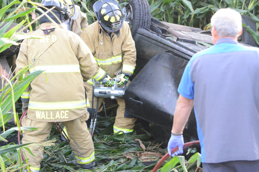 Milford Firefighters use JAWS to pry open the driver's door to free the driver.