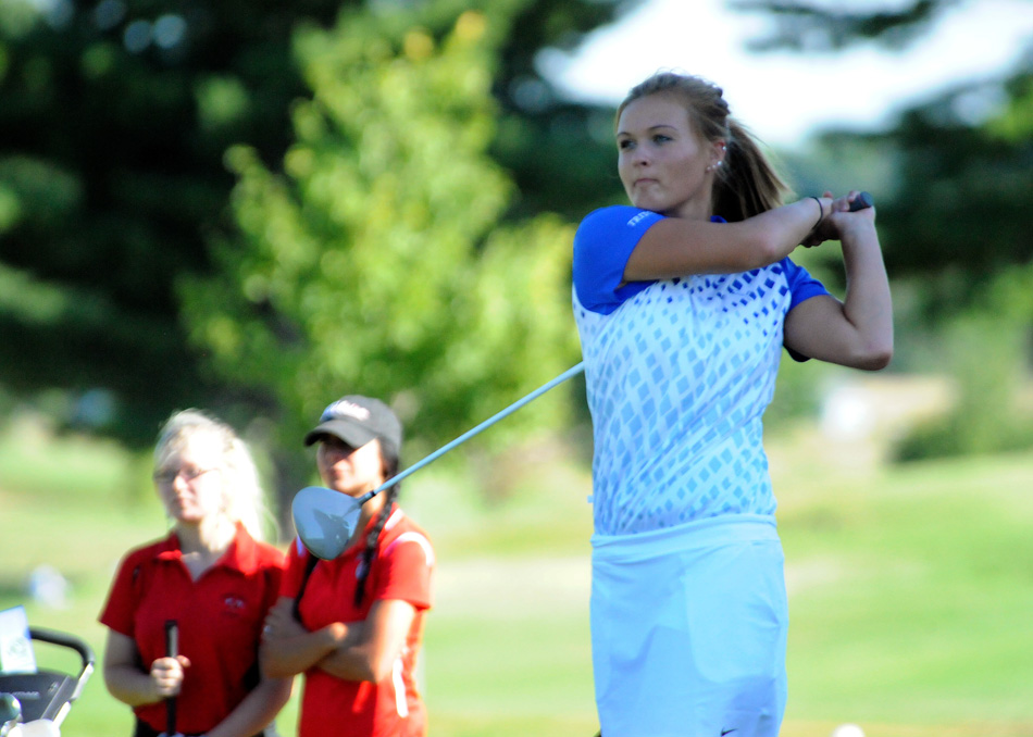 Triton's Megan McFarland tees it up Monday in the double dual against North Miami and Whitko. (Photos by Mike Deak)