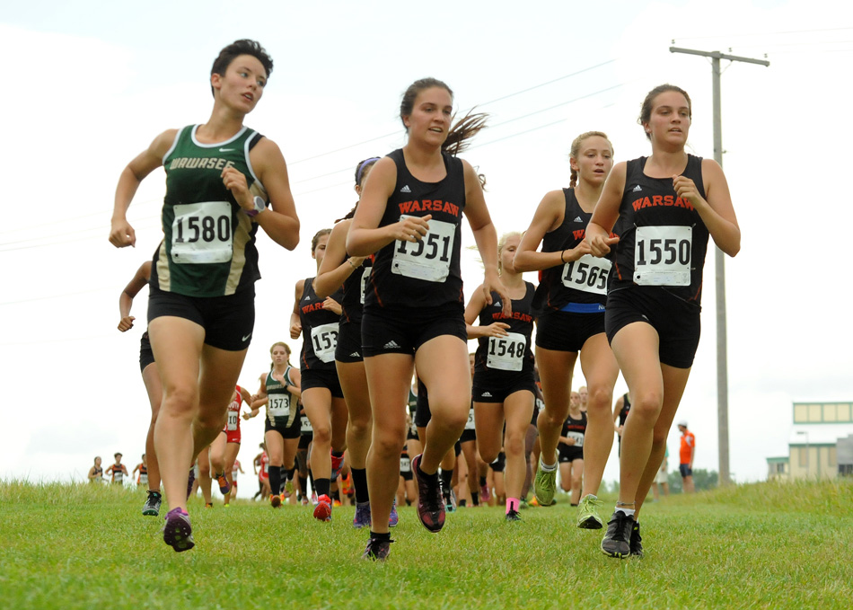 Charlene Orr, center, paces with sister Lauren, right, and Wawasee's Elizabeth Zorn during the NLC triangular Tuesday. (Photos by Mike Deak)