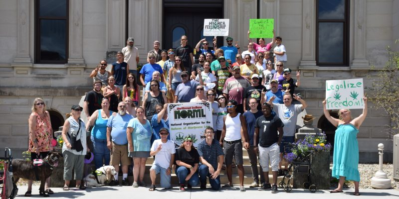 After the rally, everyone gathered on the courthouse steps to take a group photo. (Photos by Maggie Kenworthy)