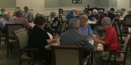 Members of the Wednesday Evening Bridge Group enjoying a game at Grace Village