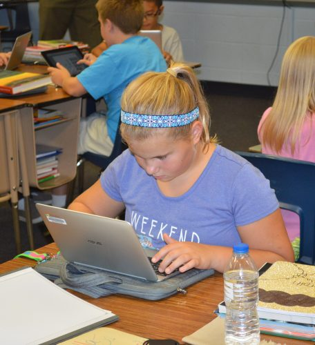 Fifth-grader Morgan Anderson uses her Chromebook while working on a math problem in Roger Brady's classroom at Syracuse Elementary.