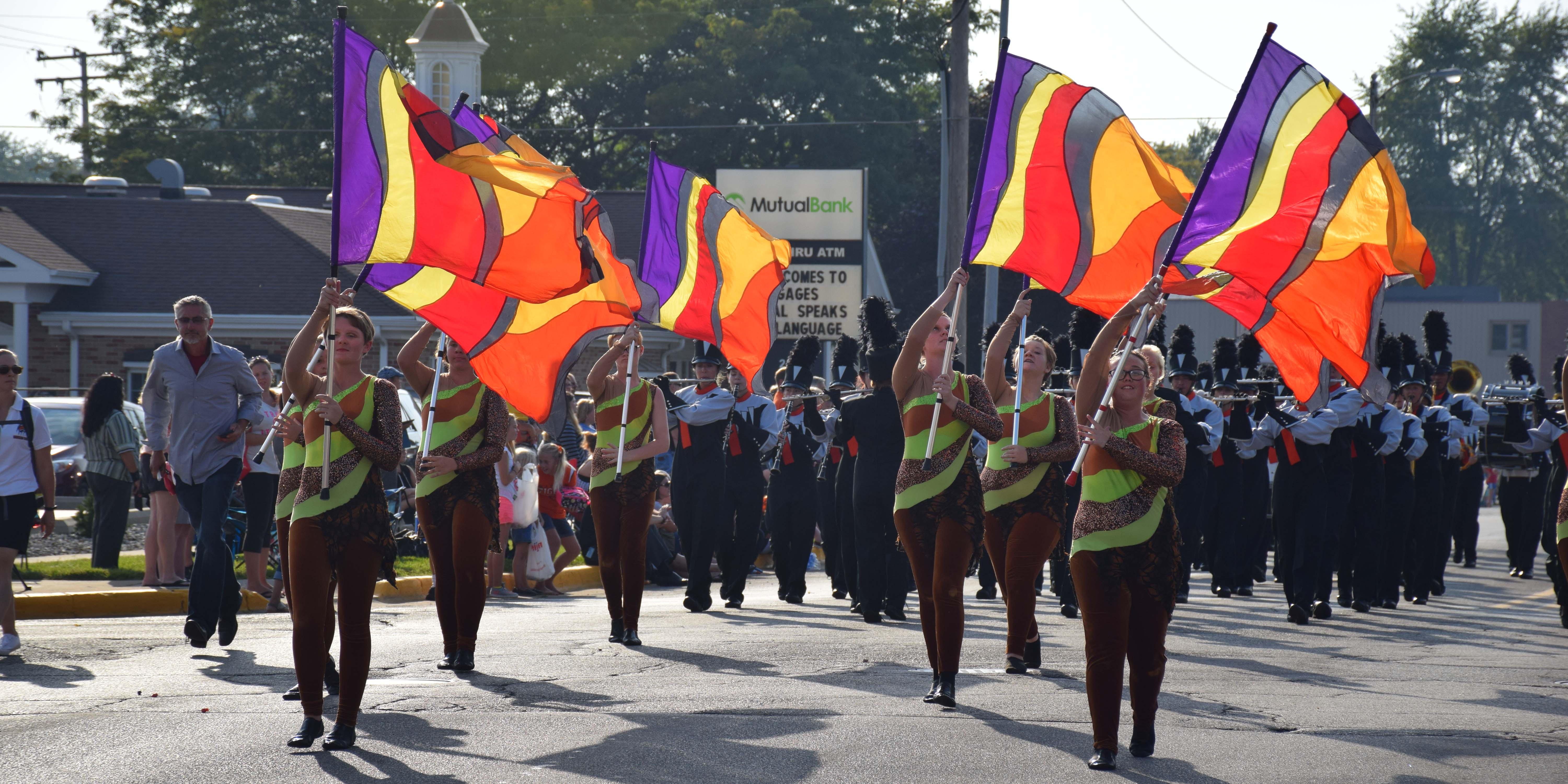The color guard travel down Market Street during the parade.