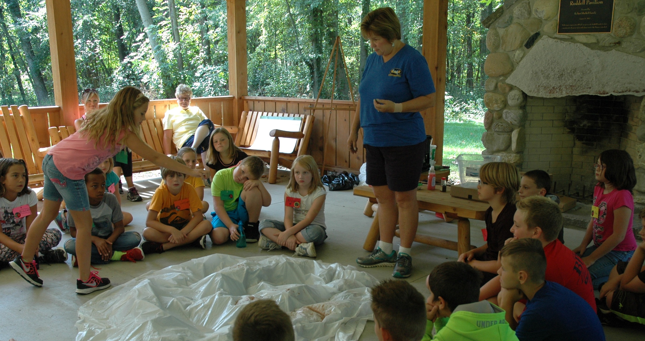 Pam Schumm allows the North Webster Elementary School fourth-graders to add pollutants to the watershed.