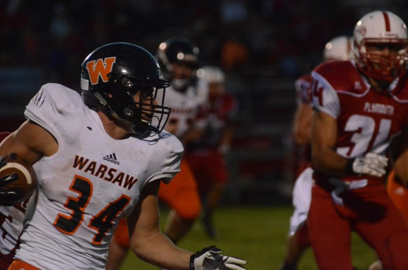 Will McGarvey rambles for a gain for Warsaw Friday night during a 17-10 NLC loss at Plymouth.