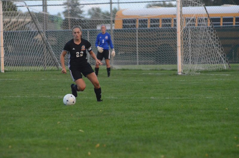 Dayle Harvey controls the ball for Warsaw Thursday night. The Tigers remained undefeated in NLC play with a 3-1 win at Concord.