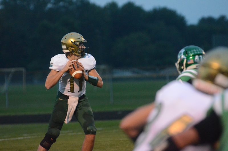 Tyler Smith looks to throw for Wawasee Friday night at Concord. The senior was spectacular in a 49-40 loss.
