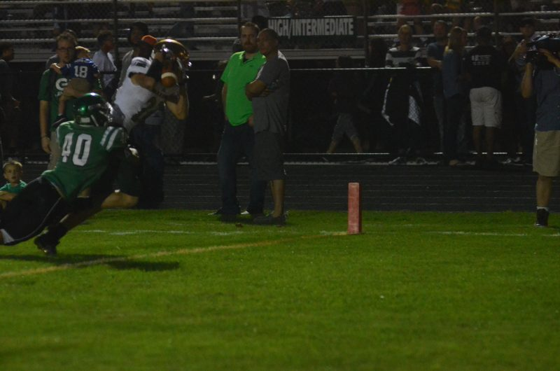 Jacob Hand makes an amazing touchdown catch for the Warriors.