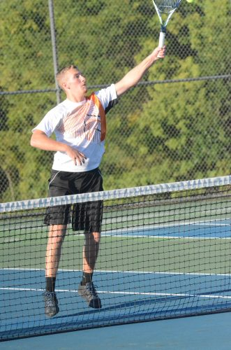 Warsaw's Hayden Steger reaches for a shot at the net at Concord Monday night.