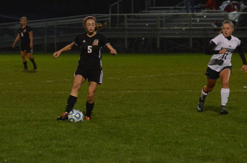 Brenna Shipley controls the ball for Warsaw versus Northridge Thursday night.
